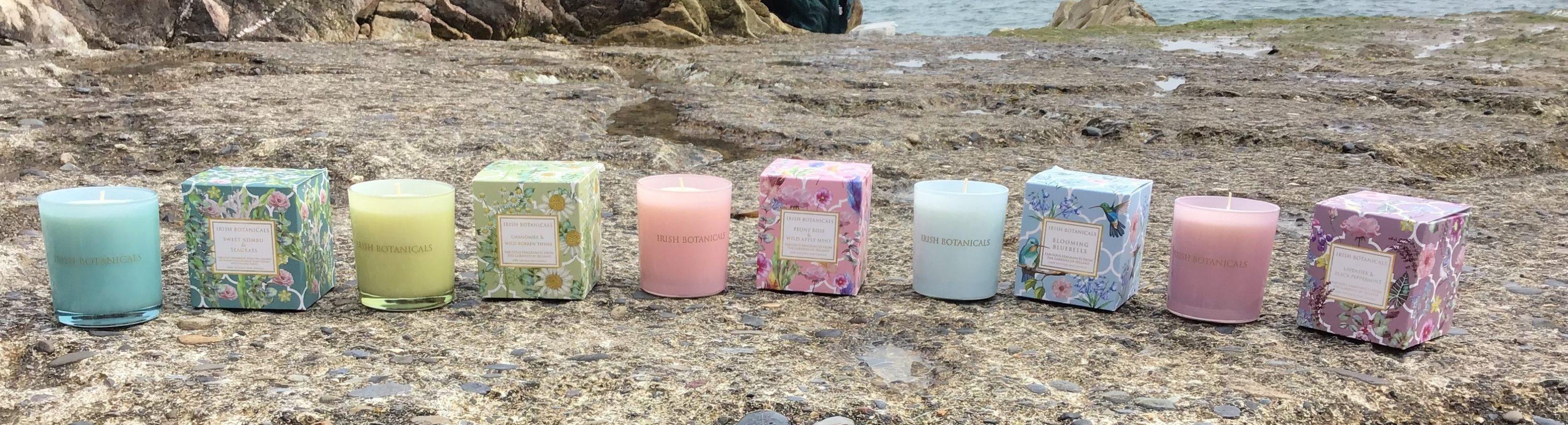 Irish Botanicals candle jars on beach