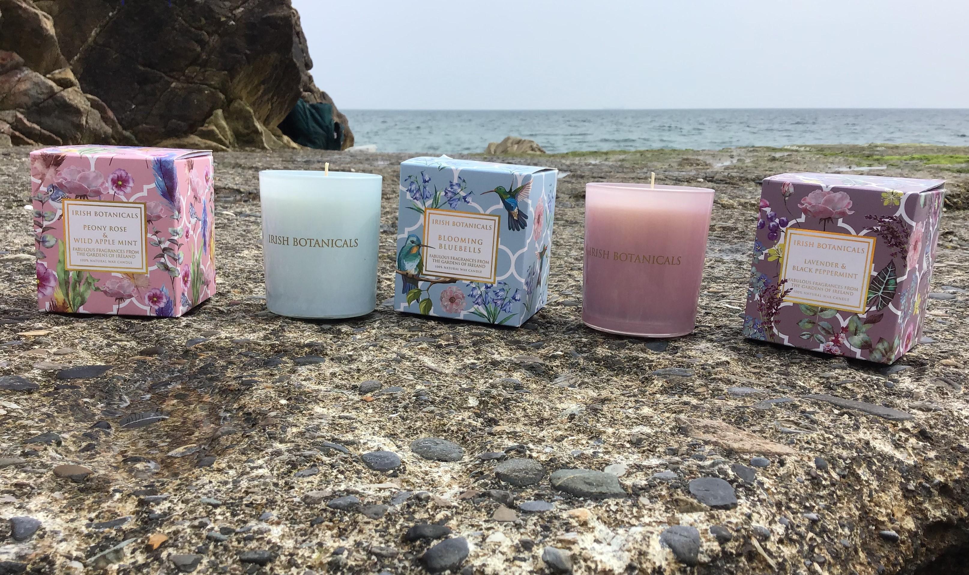 3 Irish Botanicals candle jars on the beach